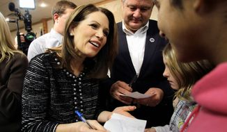 Rep. Michele Bachmann plans to touch all 99 of Iowa's counties over the final three weeks of the campaign leading up to the state's Jan. 3 caucuses. She made 13 campaign stops Saturday. (Associated Press)