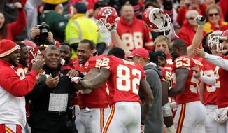 ASSOCIATED PRESS Kansas City interim coach Romeo Crennel celebrates with his team after the Chiefs ended the Green Bay's bid for a perfect season. The Packers lost for the first time since Dec. 19, 2010, at New England.