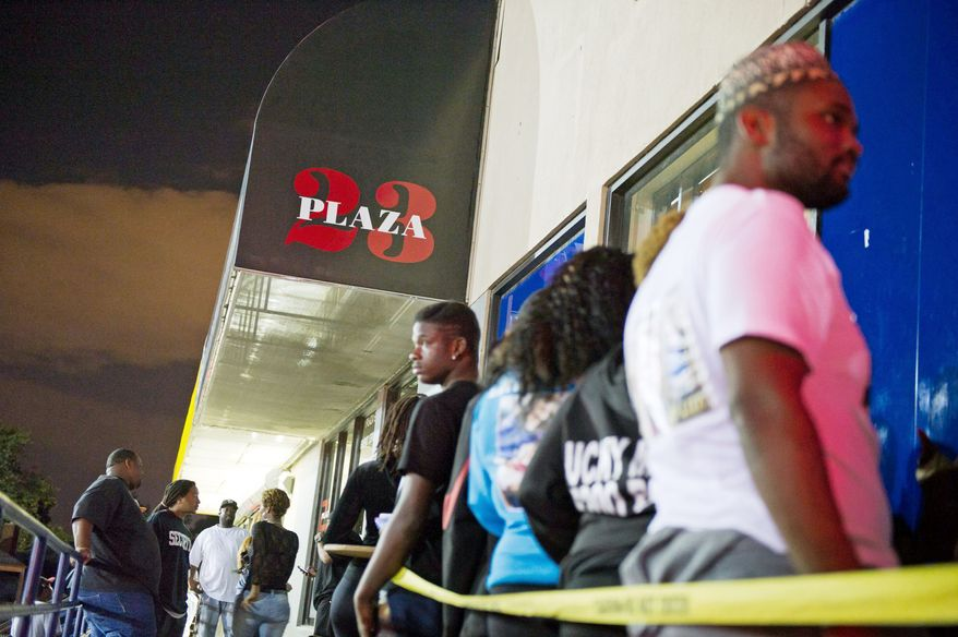 **FILE** A line forms for entry into the Plaza 23 Event Center in Temple Hills. (Andrew Harnik/The Washington Times)