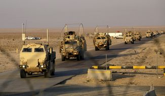 The last convoy of solders from the U.S. Army's 3rd Brigade, 1st Cavalry Division, crosses the border from Iraq into Kuwait on Sunday, Dec. 18, 2011. (AP Photo/Maya Alleruzzo)