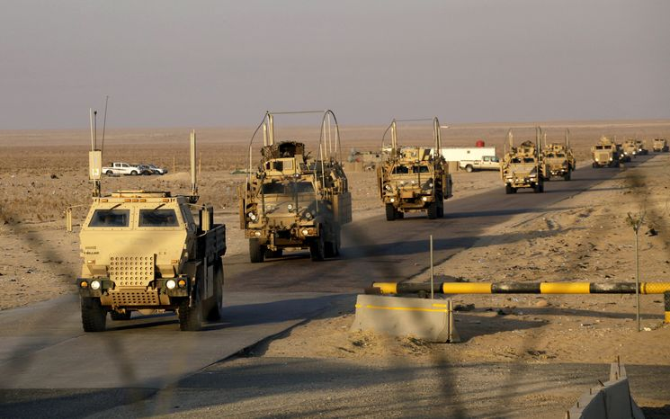 The last convoy of solders from the U.S. Army's 3rd Brigade, 1st Cavalry Division, crosses the border from Iraq into Kuwait