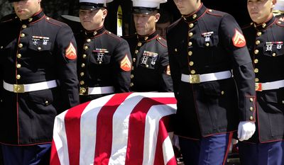 ** FILE ** Members of the U.S. Marine Corps carry the casket of Marine Pvt. Jonathan Lee Gifford at the Maranatha Assembly of God in Decatur, Ill., in April 2003. Gifford, 30, was killed just two days into the Iraq war. (AP Photo/Seth Perlman, File)