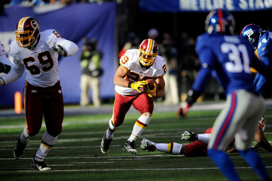 Washington Redskins running back Roy Helu (29) runs with the ball during the first quarter of an NFL football game against the New York Giants, Sunday, Dec. 18, 2011, in East Rutherford, N.J. (AP Photo/Bill Kostroun)