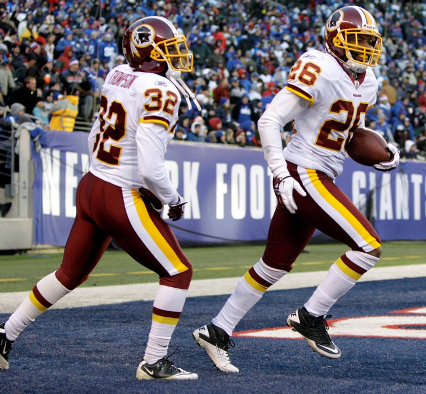 Washington Redskins' Josh Wilson, right, reacts after catching an interception in the end zone for a touchback while teammate Brandyn Thompson follows during the fourth quarter. (AP Photo/Kathy Willens)