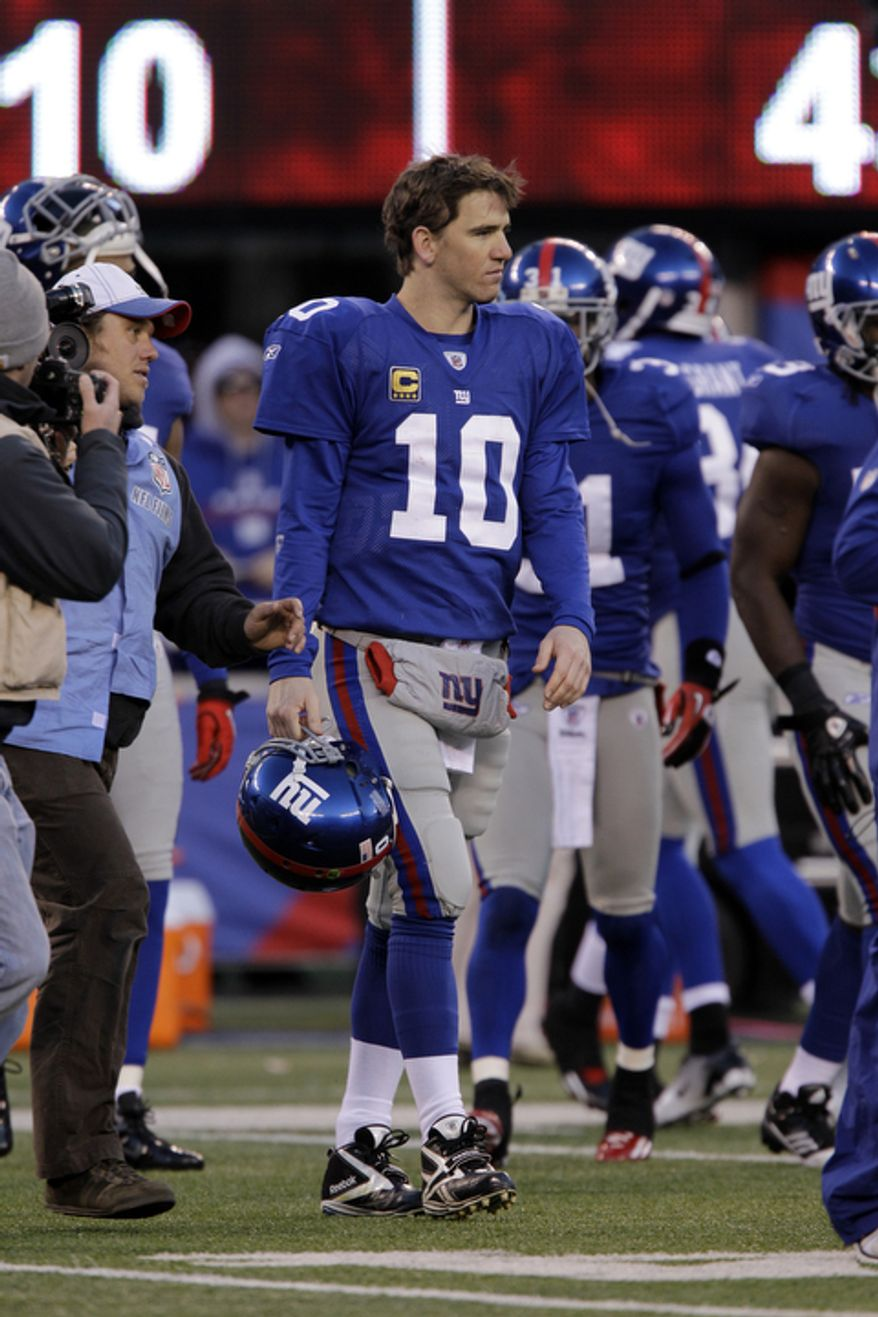 New York Giants quarterback Eli Manning (10) walks on the field at the end of an NFL football game against the Washington Redskins, Sunday, Dec. 18, 2011, in East Rutherford, N.J. The Redskins won 23-10. (AP Photo/Kathy Willens)