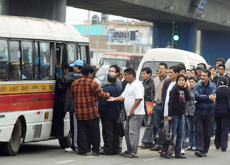 Commuters board a bus that was one of the few still operating during a 24-hour bus strike in Lima, Peru, in July. Most bus drivers struck to protest an increase in fines and the reorganization of the bus system. The nation's capital contends with exasperating traffic congestion and gridlock on major thoroughfares. (Associated Press)