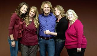 """Kody Brown and his wives, (from the left) Robyn, Christine, Meri and Janelle, are suing to overturn part of Utah's bigamy law as an invasion of privacy. The five star in TLC's reality-TV show """"Sister Wives"""" and have 17 children. (TLC via Associated Press)"""