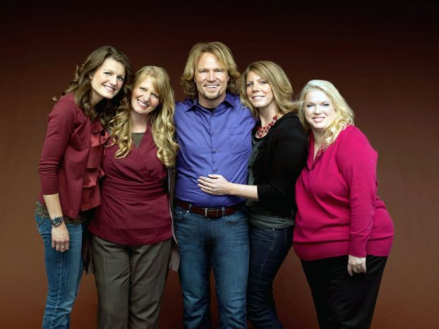 """Kody Brown and his wives, (from the left) Robyn, Christine, Meri and Janelle, are suing to overturn part of Utah's bigamy law as an invasion of privacy. The five star in TLC's reality-TV show """"Sister Wives"""" and have 17 children. (TLC via Associated P"""