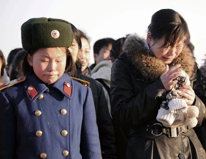 GRIEF: North Koreans were in a state of mourning in Pyongyang on Monday after learning of the demise of their leader, Kim Jong-il, who died Saturday. The Marxist dictator had inherited power from his father and ruled for 17 years. (Associated Press)