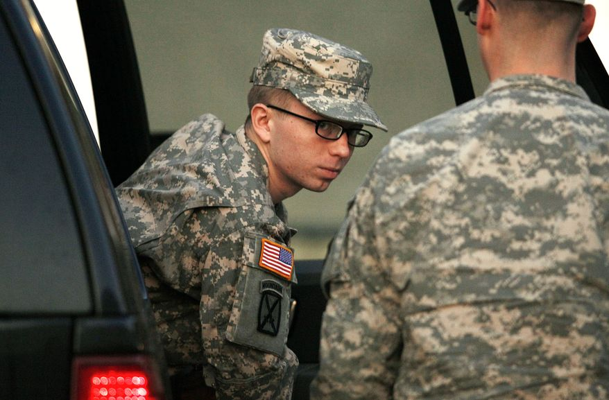**FILE** Army Pfc. Bradley Manning is escorted from a security vehicle to a courthouse at Fort Meade, Md., on Dec. 19, 2011. (Associated Press)