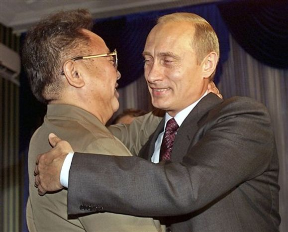 Russian President Vladimir Putin (right) greets North Korean leader Kim Jong-il during their meeting in Vladivostok, Russia, on Aug. 23, 2002. (AP Photo/Alexander Zemlianichenko, File)
