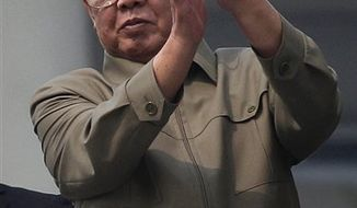 ** FILE ** North Korean leader Kim Jong-il applauds following a massive military parade marking the 65th anniversary of the communist nation's ruling Workers' Party in Pyongyang, North Korea, on Oct. 10, 2010. (AP Photo/Vincent Yu, File)
