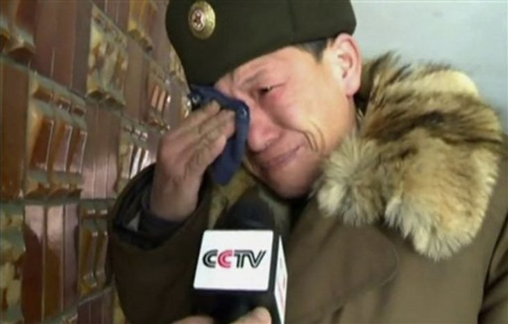 In this image made from television and provided by CCTV, China's state broadcaster, a North Korean man reacts to the death of North Korean leader Kim Jong-il in Pyongyang, North Korea, on Monday, Dec. 19, 2011. (AP Photo/CCTV)