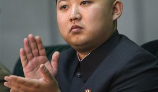 ** FILE ** In this Oct. 9, 2010, photo released by China's Xinhua News Agency, Kim Jong-un, the third son of North Korean leader Kim Jong-il, applauds while watching the Arirang mass games performance staged to celebrate the 65th anniversary of the founding of the Workers' Party of Korea in Pyongyang, North Korea. (AP Photo/Xinhua, Yao Dawei)