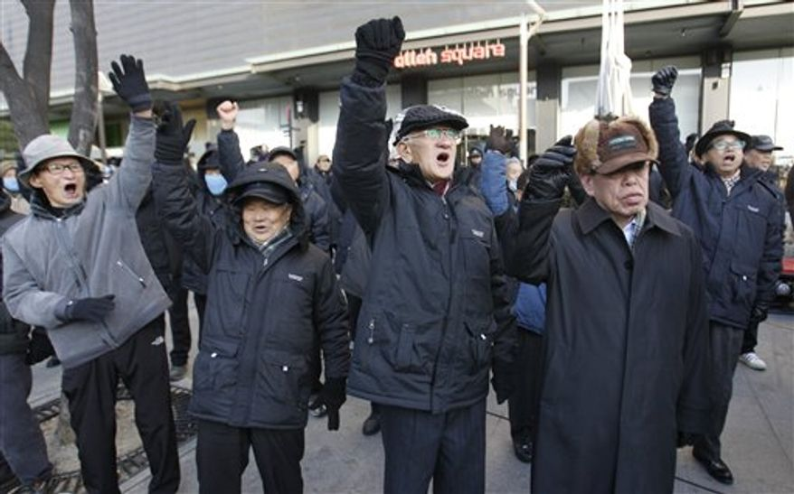 South Korean conservative protesters shout slogans during a rally in downtown Seoul on Monday, Dec. 19, 2011, to mark the death of North Korean leader Kim Jong-il. North Korean state media announced his death Monday.  (AP Photo/Lee Jin-man)