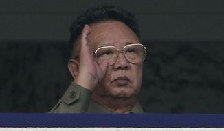 ** FILE ** North Korean leader Kim Jong-il salutes soldiers while watching a massive military parade marking the 65th anniversary of the communist nation's ruling Workers' Party in Pyongyang, North Korea, in October 2010. (AP Photo/Vincent Yu, File)