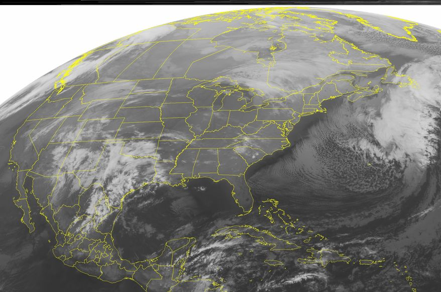 A National Oceanic and Atmospheric Administration satellite image taken on Monday, Dec. 19, 2011, at 12:45 a.m. EST shows cloud cover over the Southwest as low pressure over the region kicks up a mix of rain, freezing rain and snow. (AP Photo/Weather Underground)