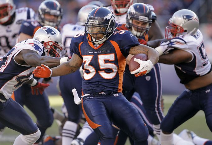 Denver Broncos running back Lance Ball (35) runs for a touchdown against the New England Patriots in the first quarter of an of an NFL football game, Sunday, Dec. 18, 2011, in Denver. (AP Photo/Barry Gutierrez)