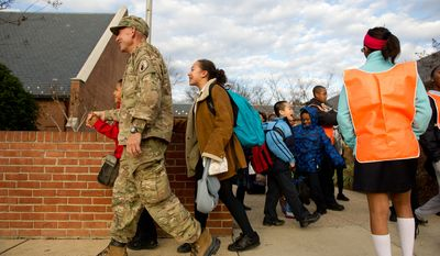 Air Force Brigadier General Select Peter Masciola head home after surprising his 10 year old son Kevin, left, and 12 year old daughter Tamara, center, at their school, Saint Columbus School, by coming home for Christmas after a 6 month deployment outside Kabul, Afghanistan, Monday, December 19, 2011. (Andrew Harnik / The Washington Times)