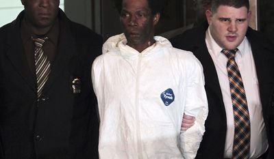 Jerome Isaac (center), the suspect in the burning death of 73-year-old Deloris Gillespie, is led from the 77th Precinct in the Brooklyn borough of New York on Sunday, Dec. 18, 2011. (AP Photo/Robert Mecea)