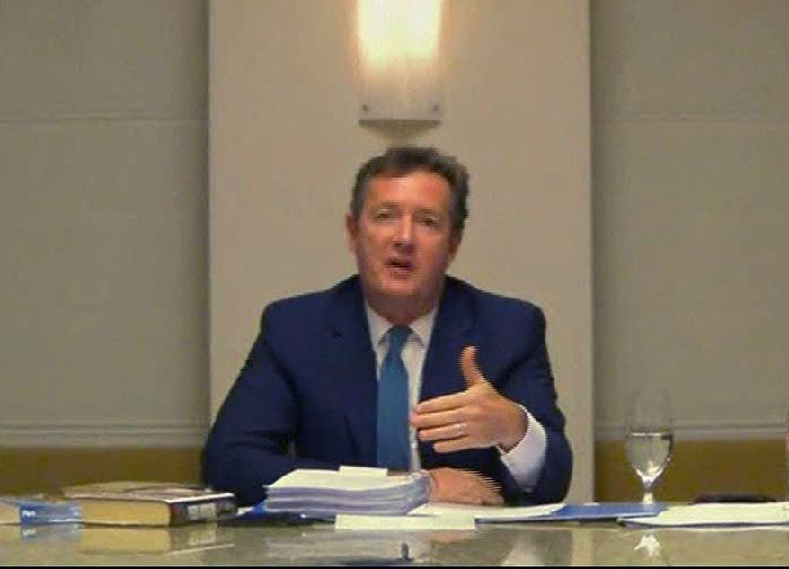 In this image made from video, CNN star interviewer Piers Morgan answers questions Tuesday, Dec. 20, 2011 from a media ethics inquiry sitting in London, England, about his time at the top of Britain's tabloid industry, at an unknown location in the U.S. Morgan ran two British tabloids - the News of the World and the Daily Mirror - before his editorship was cut short by scandal in 2004. (AP Photo, Pool)