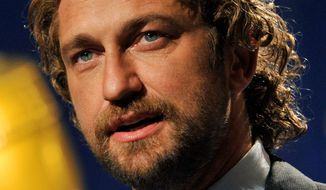 FILE - In this Dec. 15, 2011 file photo, actor Gerard Butler announces nominations for the 69th Annual Golden Globe Awards in Beverly Hills, Calif. Butler is OK after being rescued during filming for a movie at Mavericks, a treacherous Northern California surf break known for stories-high waves. (AP Photo/Chris Pizzello, File)