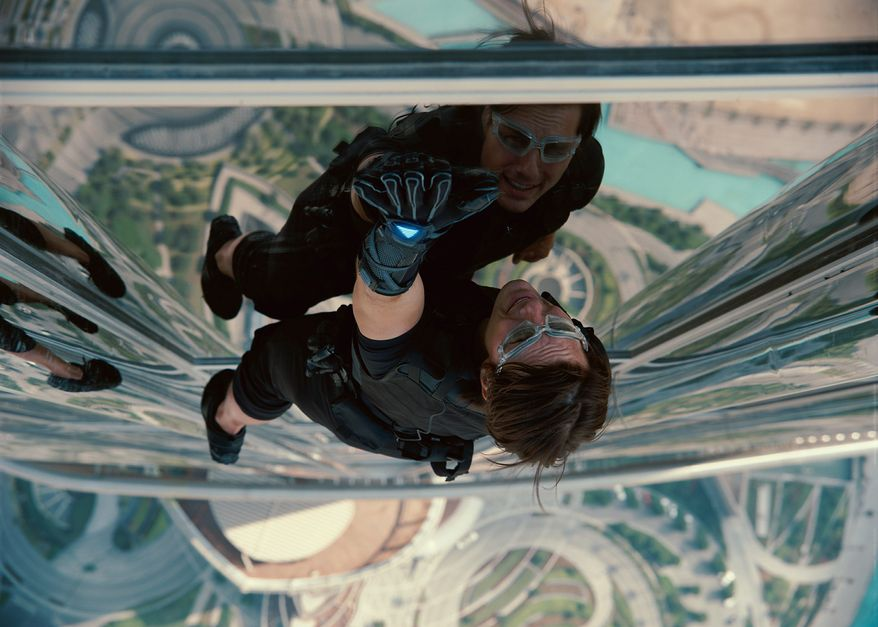 "Tom Cruise reprises his role as Ethan Hunt in a scene from ""Mission: Impossible - Ghost Protocol."" In the film, he climbs the tallest building in the world in Dubai. (Associated Press)"