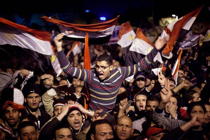 Anti-government protesters in Cairo's Tahrir Square react to a televised statement on Feb. 10, 2011, by Egyptian President Hosni Mubarak, who stepped down the following day. His departure and that of Tunisia's Zine el-Abidine Ben Ali have some seeing the twilight of U.S. influence in the Middle East and others seeing new opportunities. (Associated Press)