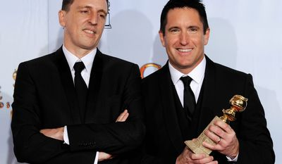 """Composers Trent Reznor (right) and Atticus Ross began scoring """"The Girl With the Dragon Tattoo"""" before production of the film had begun. (Associated Press)"""