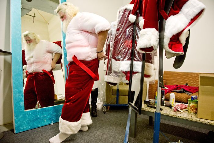 """""""That's exactly what you're supposed to do: make it look effortless."""" says Mike Graham, who """"suits up"""" for his role as Santa Claus. The married father of three has made a second career out of portraying Santa for the past 22 years. He plays the jolly fellow at Tysons Corner Center. (Andrew Harnik/The Washington Times)"""