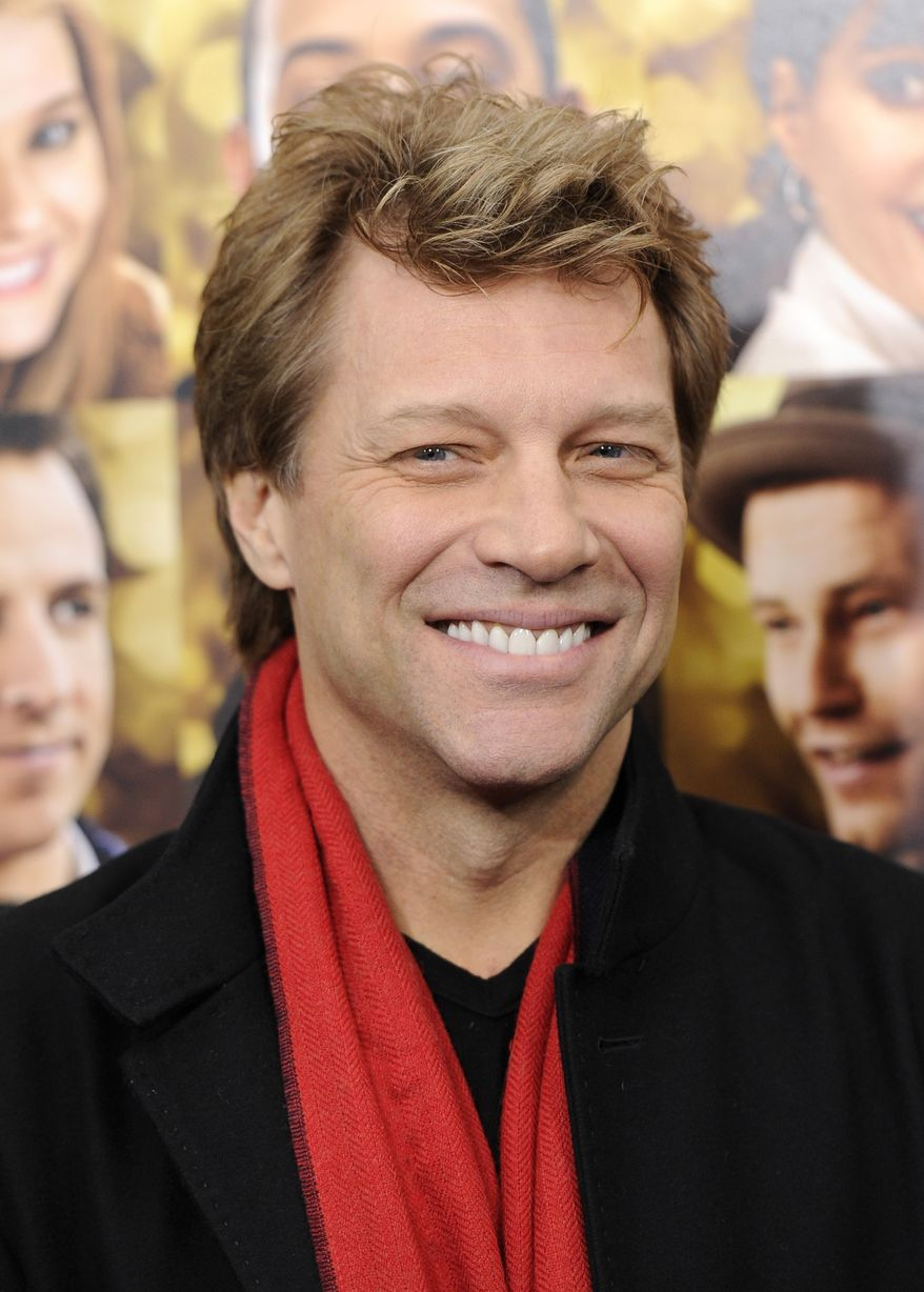 """** FILE ** In a Wednesday, Dec. 7, 2011, file photo, singer Jon Bon Jovi attends the premiere of """"New Year's Eve"""" at the Ziegfeld Theatre in New York. Bon Jovi wants fans to know he's not dead, and he has posted a photo proving it. (AP Photo/Evan Agostini, File)"""