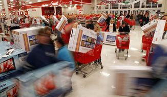 ** FILE ** Shoppers grab up televisions at a store in Knoxville, Tenn., minutes after it opened on Black Friday, Nov. 25, 2011. (AP Photo/The News Sentinel, Wade Payne)
