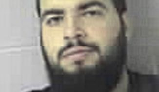 ** FILE ** This Wednesday, Oct. 21, 2009, file booking photo provided by the Sudbury, Mass., Police Department shows Tarek Mehanna, of Sudbury, after he was arrested and charged with conspiring to plot terror attacks. The jury found him guilty, Tuesday, Dec. 20, 2011, on four terror-related charges and three charges of lying to authorities after deliberating for about 10 hours. (AP Photo/Sudbury Police Department, File)