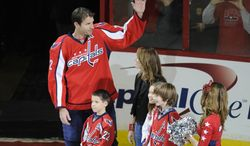 Washington Capitals right wing Mike Knuble acknowledges the crowd during a pregame ceremony to mark his 1,000th NHL game before a matchup against the Nashville Predators on Tuesday, Dec. 20, 2011, in Washington. (AP Photo/Nick Wass)