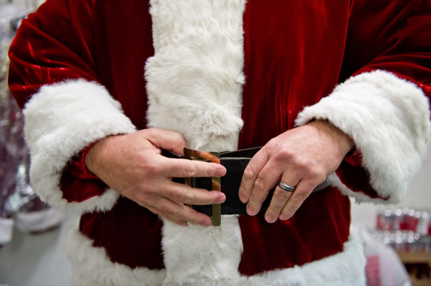 Michael Graham, who plays Santa, gets ready for his morning shift as Santa. (Andrew Harnik / The Washington Times)