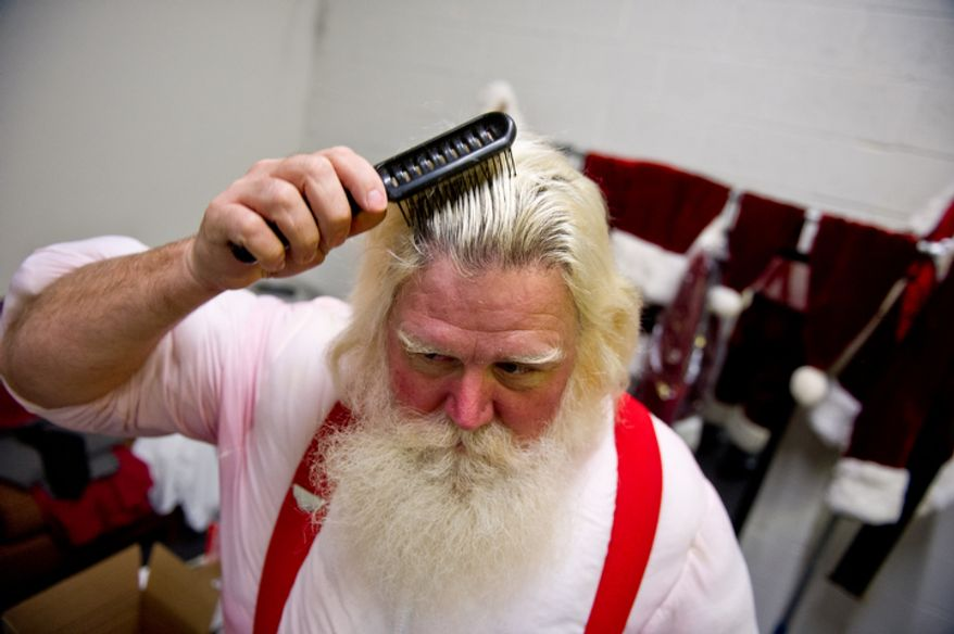 Michael Graham, who plays Santa, changes back into civilian cloths in his dressing room for his afternoon lunch break. (Andrew Harnik / The Washington Times)