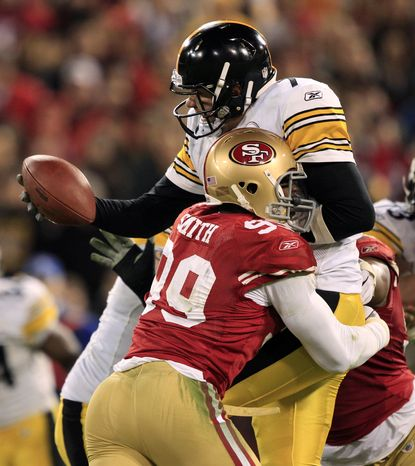 Pittsburgh Steelers quarterback Ben Roethlisberger (7) gets sacked by San Francisco 49ers linebacker Aldon Smith (99) and Ray McDonald (not seen) in the fourth quarter of an NFL football game against the Pittsburgh Steelers in San Francisco, Monday, Dec. 19, 2011. (AP Photo/Marcio Jose Sanchez)