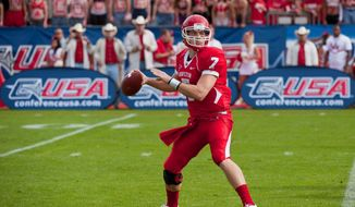 Houston quarterback Case Keenum will end his college career as the leading passer in NCAA history, but he's not considered a starter on the NFL level. (Associated Press)