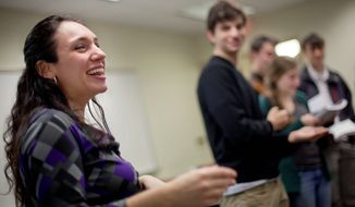 """Miriam Udel leads a song in Yiddish at Emory University in Atlanta. """"The generation that passively knows Yiddish is dying out. There are treasures that need to be preserved because we'll lose access to them if we let Yiddish die,"""" she says. (Associated Press)"""