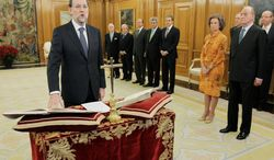 Mariano Rajoy (left) is sworn in before King Juan Carlos (right) to become Spain's new prime minister at the Zarzuela Palace in Madrid on Wednesday, Dec. 21, 2011. Mr. Rajoy's Popular Party won a landslide victory in the Nov. 20 elections on promises to lift Spain out of its economic crisis. (Associated Press)