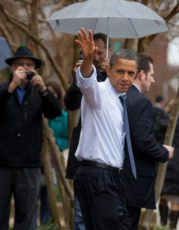 President Obama waves to people gathered outside in the rain as he shops for Christmas gifts Wednesday in Alexandria. The president's spokesman said Mr. Obama's assertion that he ranked among the greatest presidents was taken out of context. (Associated Press)