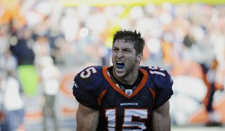 Denver Broncos quarterback Tim Tebow celebrates the first touchdown in the first quarter of an NFL football game on Sunday, Dec. 18, 2011 at Sports Authority Field at Mile High in Denver. (AP Photo/The Denver Post, Steve Nehf)
