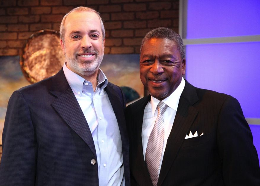 """Financial whiz Ric Edelman and BET founder and business man Robert Johnson talk up """"business solutions to social problems."""" (image from 3 Roads Communications)"""