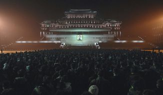 Mourners gather in Kim Il-sung Square in Pyongyang, North Korea, on Tuesday, Dec. 20, 2011, to pay their respects to North Korean leader Kim Jong-il, who died Saturday. (AP Photo/Korean Central News Agency via Korea News Service)