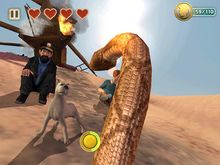 Snowy fights a snake in the iPad game The Adventures of Tintin.