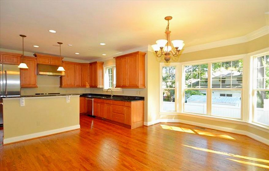 The center-island kitchen has granite counters, stainless steel appliances and 42-inch cabinets.
