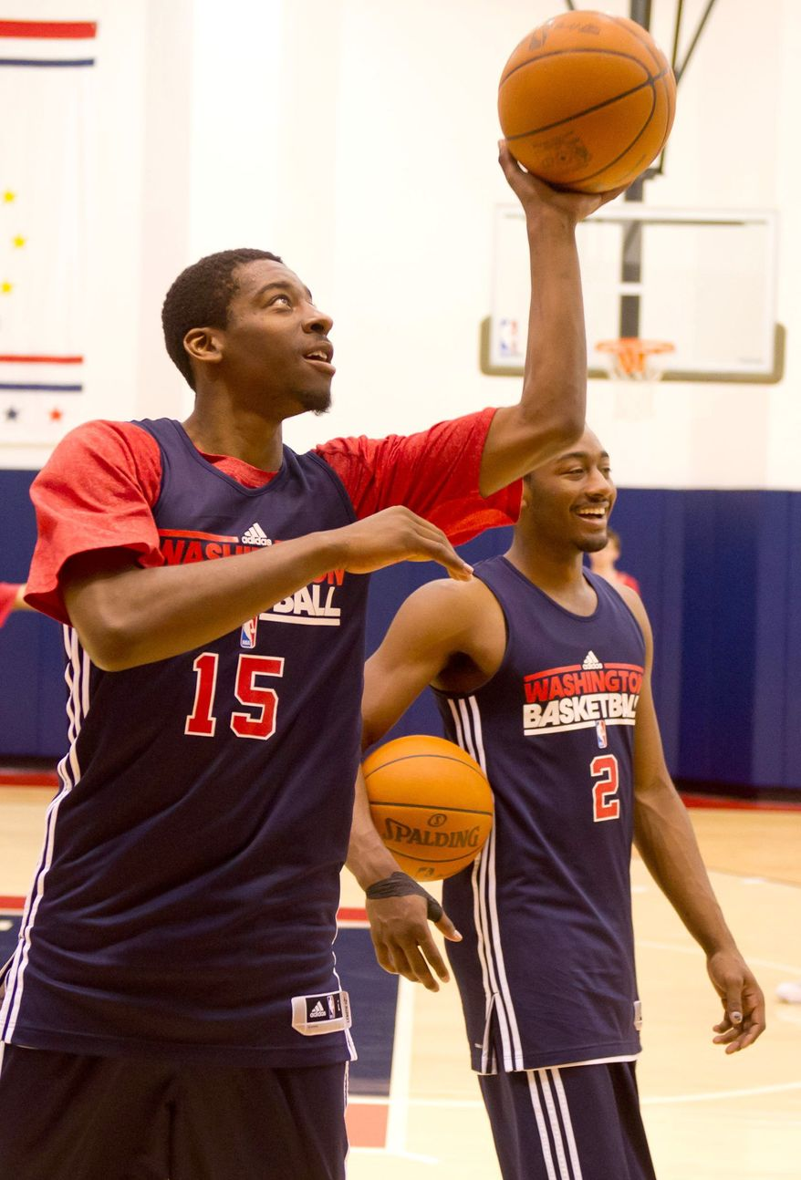 Wizards guards Jordan Crawford (left) opted for more shooting practice after Washington's two preseason losses. John Wall (right) had just six assists to go with 10 turnovers. (Andrew Harnik / The Washington Times)