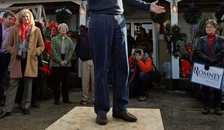 Former Massachusetts Gov. Mitt Romney, a Republican presidential candidate, gets up on his soapbox to deliver a stump speech during a campaign stop at a feed store in Lancaster, N.H., on Thursday. (Associated Press)