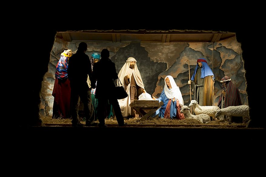"Visitors are silhouetted as they view the Nativity scene during the 34th annual ""Festival of Lights"" at the Church of Jesus Christ of Latter-day Saints' Washington Temple in Kensington, Md., on Wednesday, Dec. 14, 2011. (The Washington Times) ** FILE **"
