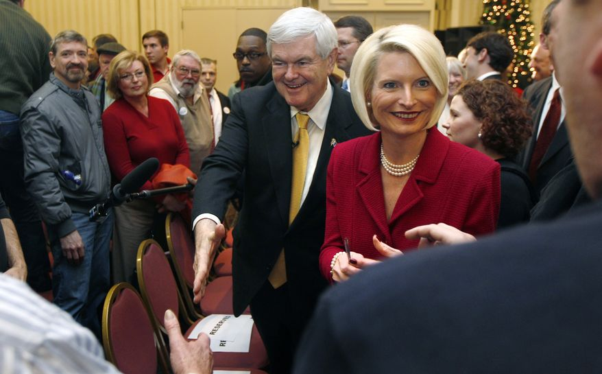 Former House Speaker Newt Gingrich and his wife, Callista, greet supporters during a presidential campaign stop in Manchester, N.H., on Wednesday, Dec. 21, 2011. (AP Photo/Charles Krupa)